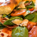 Salad with prosciutto, tomatoes and parmesan